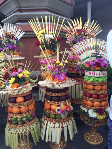 Exquisite offerings carried by Balinese women to the temple