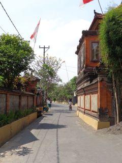 Walk the quiet village streets.