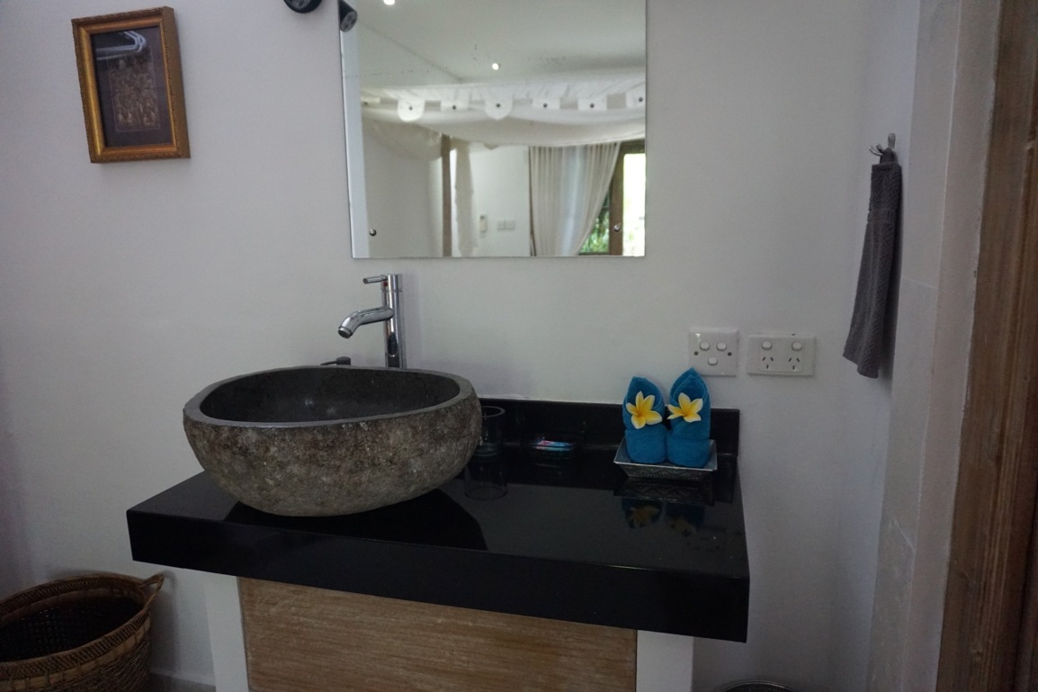 Hand carved stone wash basin