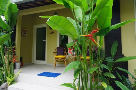 Jepun suite with private entrance and own veranda with chairs and table.