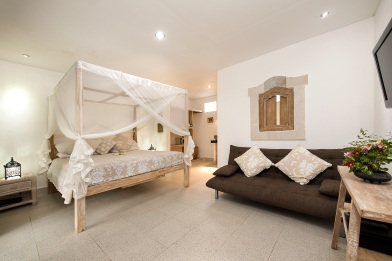 Sandat suite with king bed 200cm x 200cm and draped mosquito net.